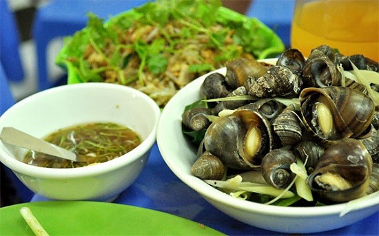 """Boiled snails: Like many other places across Vietnam, boiled snails become indispensable dishes of Hanoians when the winter comes. Snails are often soaked with chilly in order to make them """"open the mouth"""" to release dust and sand inside before being boiled."""
